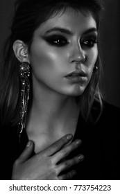 Portrait of a beautiful blonde woman in earrings.