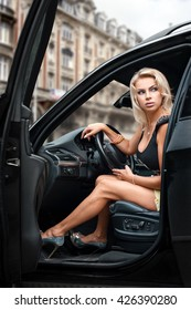 Portrait of beautiful blonde woman  in her comfortable car