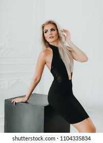 Portrait of beautiful blonde woman with makeup in fashion black clothes