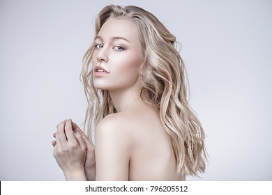 Portrait of a beautiful blonde woman with natural make-up. Beauty, cosmetics concept. Healthcare. White background.