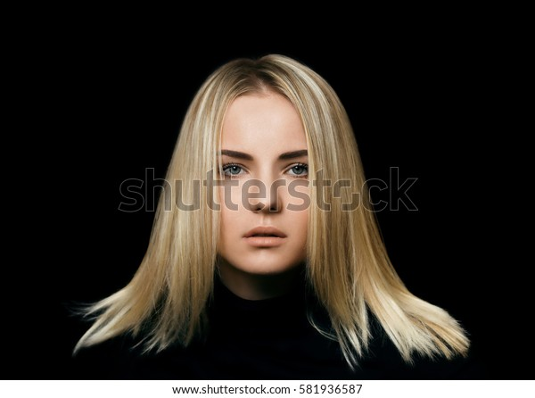 Portrait of beautiful blonde woman on the black background