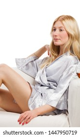 portrait of beautiful blonde woman in pajamas lingerie on white background