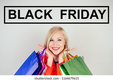 portrait of beautiful blonde woman shopaholic in a red coat with shopping bags . concept of shopaholism and sales . copyspace black friday