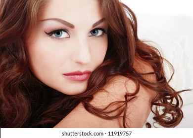 Portrait of beautiful blue-eyed girl with curling hair