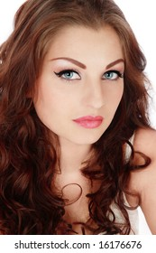 Portrait of beautiful blue-eyed girl with curling hair and trendy makeup