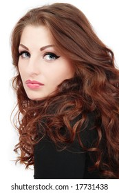 Portrait of beautiful blue-eyed girl with gorgeous curling hair and trendy makeup