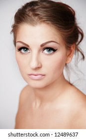Portrait of beautiful blue-eyed girl with trendy makeup, selective focus