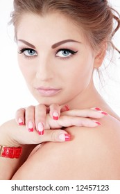 Portrait of beautiful blue-eyed woman with trendy makeup and perfect skin and nails