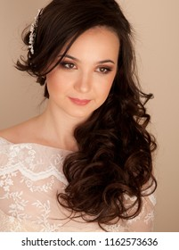 Portrait of beautiful bride with curly hairstyle and makeup