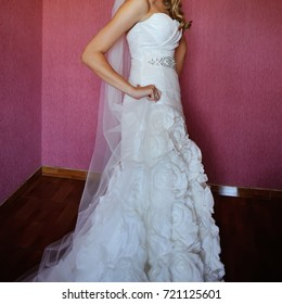 portrait of a beautiful bride in stylish wedding dress