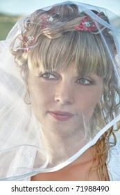 portrait of a beautiful bride with veil close up