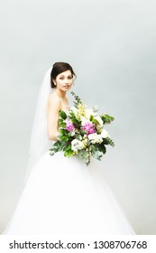 Portrait of a Beautiful Bride with a Wedding Bouquet
