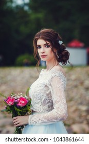 portrait of beautiful bride in wedding dress outdoors