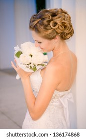 Portrait of a beautiful bride with wedding hairstyle
