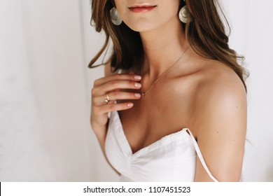 Portrait of a beautiful bride in white dress