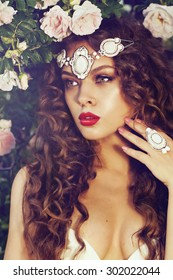 portrait of a beautiful brunet with accessories in the summer garden