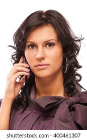 portrait of beautiful brunette with cellphone on white