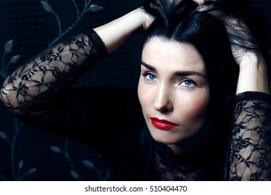 portrait of beautiful brunette girl with blue eyes and red lips
