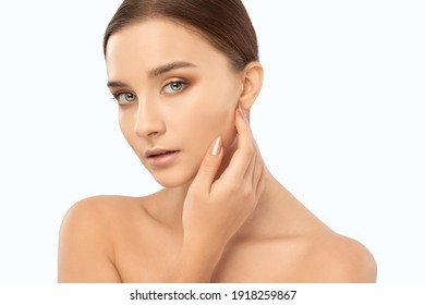 Portrait of a beautiful brunette girl with healthy clean skin and fresh make-up. Aesthetic cosmetology and makeup concept.
