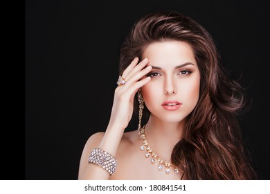 portrait of a beautiful brunette girl with luxury accessories.Beauty with jewellery. fashion model