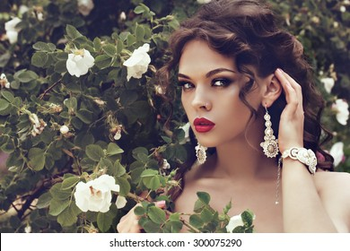 portrait of a beautiful brunette girl with luxury accessories. Beauty with jewelry.