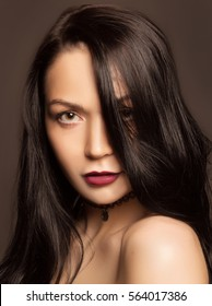 portrait of a beautiful brunette on a gray background