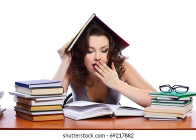 portrait of beautiful brunette student girl with books looking tired and sleepy