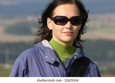 Portrait of beautiful brunette with sun glasses in autumn