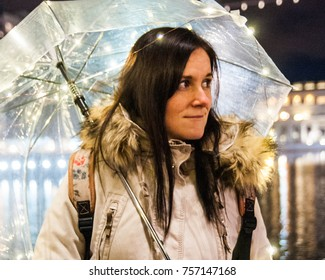 Portrait of a beautiful Brunette with an umbrella decorated with light string