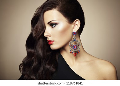 Portrait of beautiful brunette woman in black dress. Fashion photo