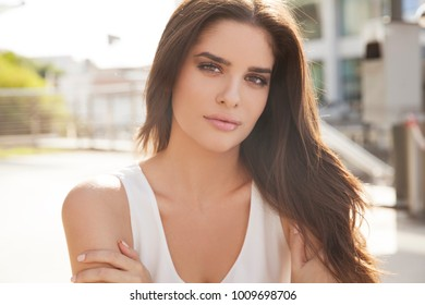 Portrait of beautiful Brunette woman with bright makeup and long hair. Outdoors shot, Horizontal