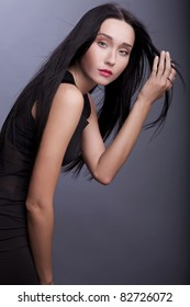 Portrait of a beautiful brunette woman. Fashion Photo.