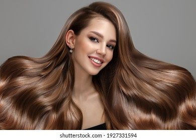 Portrait of a beautiful brunette woman with long wavy hair. Copycpase - Shutterstock ID 1927331594