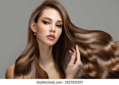 Portrait of a beautiful brunette woman with long wavy hair. Copycpase