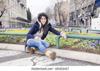 Portrait of beautiful brunette woman  relaxing in the garden