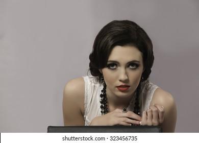 Portrait of beautiful brunette woman representing Coco Chanel