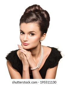 portrait of beautiful brunette woman wearing pearl  jewelry. looking at camera. retro style