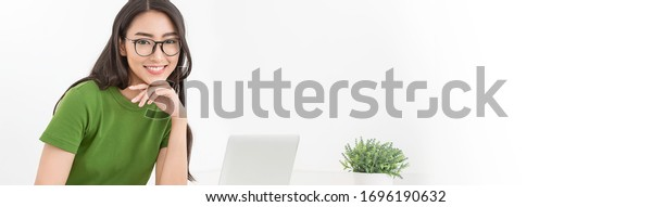Portrait of beautiful business asian woman working in office desk using computer. Small business freelance girl. Successful business people employee, sme online marketing banner