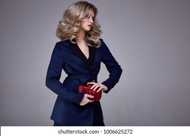 Portrait beautiful business woman lady boss style perfect blond hair wear blue formal suit elegance casual style secretary diplomatic protocol office uniform stewardess air hostess accessory bag.