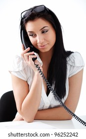 Portrait of beautiful business woman on phone call over white background
