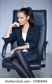 Portrait of beautiful business woman sitting on chair