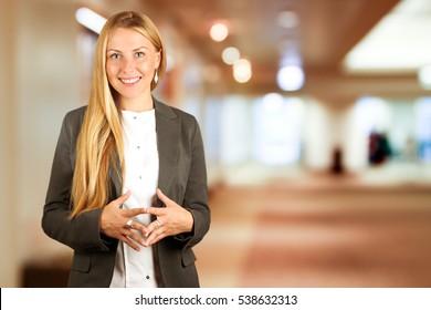 Portrait of  beautiful business woman standingon a blue background