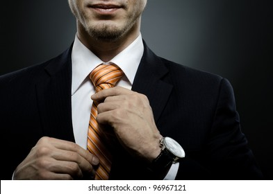 portrait  the  beautiful  businessman  in black costume tie one's necktie
