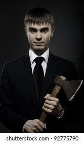 portrait  the  beautiful  businessman careerist in black costume and black necktie with axe