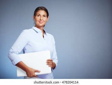 Portrait Of A Beautiful Businesswoman Holding Her Laptop