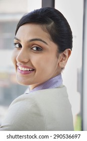 Portrait of beautiful businesswoman smiling while looking at camera