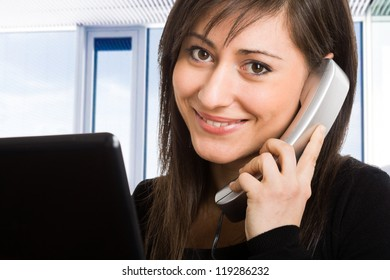Portrait of a beautiful businesswoman talking on the phone