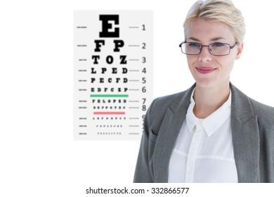 Portrait of beautiful businesswoman wearing glasses against eye test