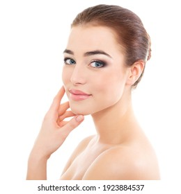 Portrait of beautiful calm woman with young clean healthy skin, studio shot isolated on white background. Anti-aging and beauty treatment.