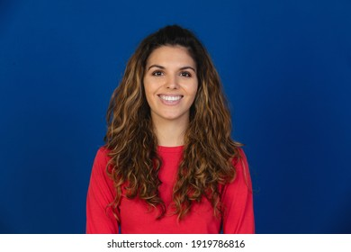 Portrait of beautiful caucasian girl with curly hair isolated on a white background
